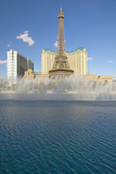 Water Fountain Display at Bellagio Casino with Paris Casino and Eiffel Tower in Las Vegas  NV