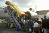Executives Boarding a Passenger Jet in Hong Kong