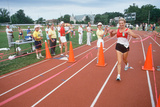 A Female Runner Crossing the Finish Line at the Senior Olympics  St Louis  MO
