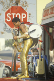 A One-Man Band in a Gold Lame Costume Performing on the Street  Venice  CA