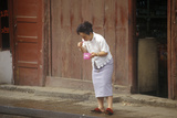 Woman Brushing Teeth Outdoors in Kunming  Yunnan Province  People's Republic of China