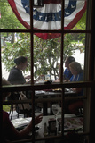 Through the Window  People Have Lunch at the Historic Colonial Inn  Concord  Ma  Memorial Day  2011