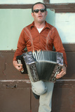 A Man Playing an Accordion  NM