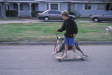 Kids on Skateboard Being Pulled by Dog in Oak View CA
