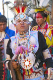 Close-Up Portrait of Native American in Full Regalia Dancing at Pow Wow