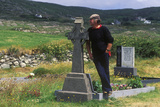 Man Standing by Grave Marker in Kilcatherine Church Cemetery  Cork  Ireland