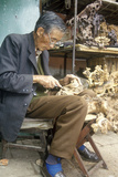 Woodcarver in Marketplace in Kunming  Yunnan Province  People's Republic of China