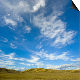 Lofty cumulus and cirrus clouds over sagebrush prairie