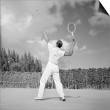 1930s Back View of Man Playing Tennis About to Hit the Ball Summer Outdoor