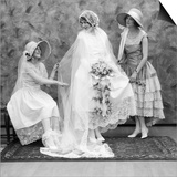 1900s-1910s Bride with One Bridesmaid on Either Side Helping Fix Her Wedding Dress