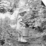 Little Girl with Hat and Pail Outdoors
