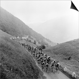 Contestants in the Grueling Tour De France are Seen on Their Way to the Mente Pass