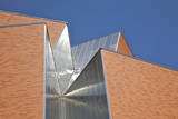 Detail of Aluminum and Brick against Blue Sky