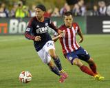 Aug 23  2014 - MLS: Chivas USA vs New England Revolution - Lee Nguyen  Bobby Burling