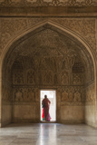 India  Uttar Pradesh  Agra  Agra Fort  a Woman in a Red Saree Walks Through the Interior