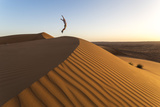 Oman  Wahiba Sands Tourist Jumping on the Sand Dunes (Mr)