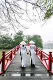 Vietnam  Hanoi  Hoan Kiem Lake Walking on Huc Bridge in Traditional Ao Dai Dress
