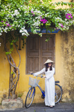 Woman Wearing Ao Dai Dress with Bicycle  Hoi An  Quang Ham  Vietnam
