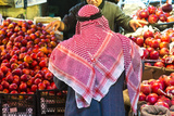 Arab Man Waerinf Keffiyeh Buying Apples in Market  Amman  Jordan