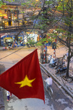 Vietnamese Flag and Street Scene  Hanoi  Vietnam