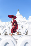 Myanmar  Mandalay Division  Mingun Novice Monk with Red Umbrella Jumping on Hsinbyume Pagoda (Mr)