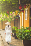 Woman Wearing Ao Dai Dress Walking Along Street  Hoi An  Quang Ham  Vietnam