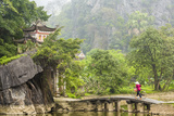 Woman Crossing Bridge with Bicycle to Temple  Tam Coc Nr Ninh Binh  Nr Hanoi  Vietnam