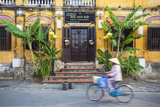 Woman Riding Bicycle Past Restaurant  Hoi an (Unesco World Heritage Site)  Quang Ham  Vietnam