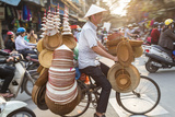 Basket and Hat Seller on Bicycle  Hanoi  Vietnam