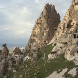 Sheep Graze on the Hillside of Rock Formations Near Caves Used as Refuge by Early Christians