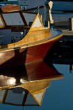 An Antique Powerboat Reflected in the Calm Water of Bass Harbor  Maine