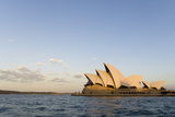 A View of the Sydney Opera House from across the Harbor at Sunset