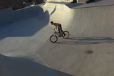 A Young Man Riding a Bike in a Skate Park in Gijon  Spain