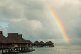 A Rainbowover the Ocean and Vacation Cottages on Bora Bora
