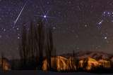 A Bright Meteor Streaks the Sky Near Sirius  the Brightest Star in the Night Sky