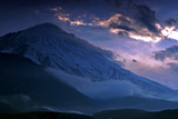 A Lavender Sky Appears Behind Snowy Mount Damavand  the Highest Peak in the Middle East
