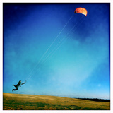 A Boy Takes Flight While Sand Kiting at Jockey Ridge State Park