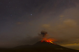 The Tungurahua Volcano Erupting at Night under a Starry Sky