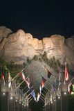 State Flags Line the Walkway Leading to Mount Rushmore National Monument  at Night