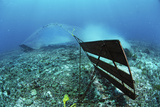 A Bottom Trawler Scrapes the Ocean Floor Destroying the Habitat
