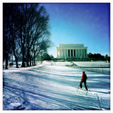 A Woman Cross Country Skiing Towards the Lincoln Memorial