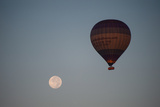 The Moon and a Hot Air Balloon Above the Desert Near the Valley of the Kings