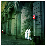 Two Nuns Walk Through the Old Fortress City of Orvieto  Umbria  Italy
