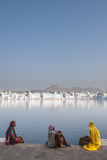 Three Elderly  Sari-Clad Indian Women Sitting on the Shore of Pushkar Lake