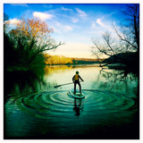 A Boy Make Ripples with His Standup Paddle Board on the Potomac River