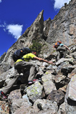 Two People Scramble Up a Scree Slope to Climb Crystal Tower