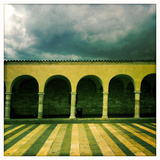 Covered Walkway and Storm Clouds Above San Francis of Assisi Basilica Square