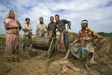 Villagers of Jaghati Threshing Rice
