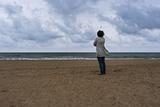 April Alvarez Looks Out at the Stormy Atlantic Ocean
