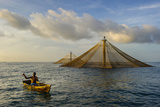 Diamond-Shaped Fish Cages Rise from the Water